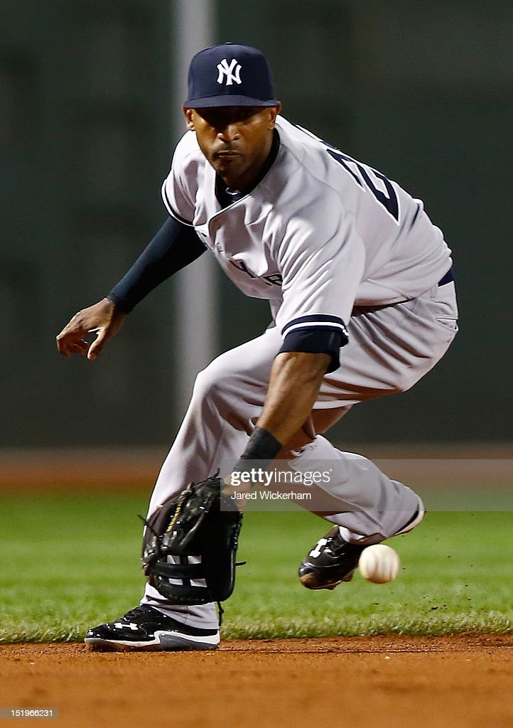 Eduardo Nunez #26 of the New York Yankees fields a ground ball against the Boston Red Sox during the game on September 13, 2012 at Fenway Park in Boston, Massachusetts.