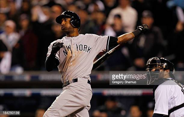 Eduardo Nunez of the New York Yankees hits a solo home run in the top of the ninth inning against the Detroit Tigers during game three of the...