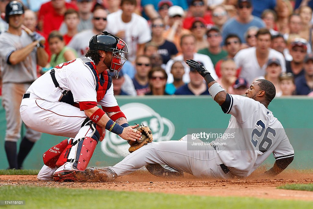 Eduardo Nunez #26 of the New York Yankees is tagged out at home plate by Jarrod Saltalamacchia #39 of the Boston Red Sox in the fifth inning during the game on July 20, 2013 at Fenway Park in Boston, Massachusetts.
