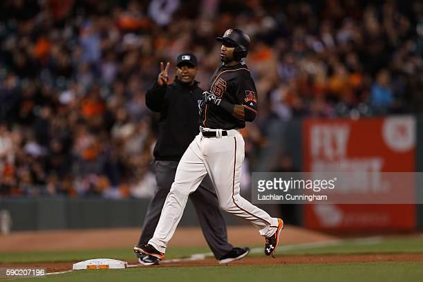 Eduardo Nunez of the San Francisco Giants advances to third base on a groundrule double hit by Joe Panik of the San Francisco Giants in the sixth...