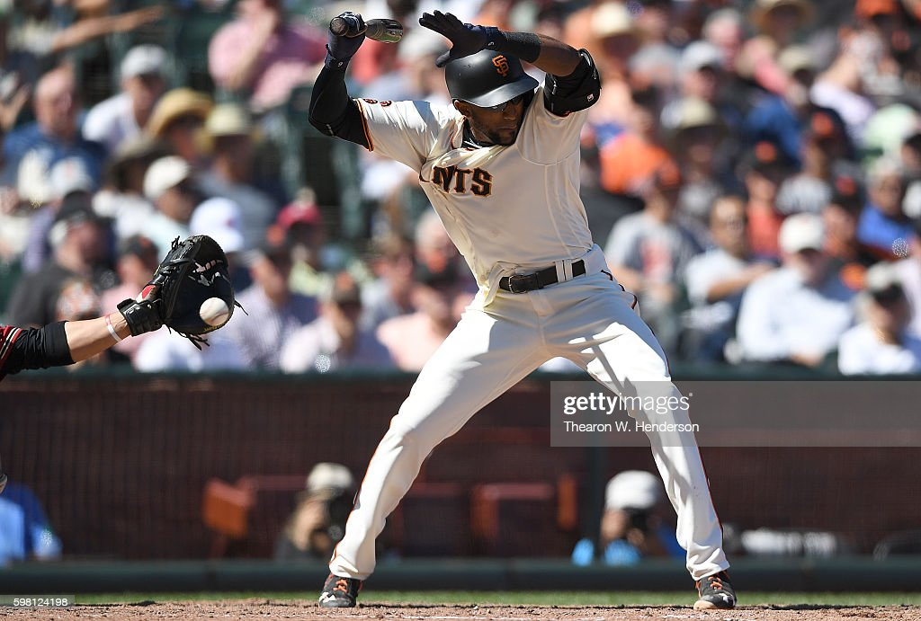 Eduardo Nunez #10 of the San Francisco Giants jumps back but gets hit by a pitch from Shelby Miller #26 of the Arizona Diamondbacks in the bottom of the six inning at AT&T Park on August 31, 2016 in San Francisco, California.