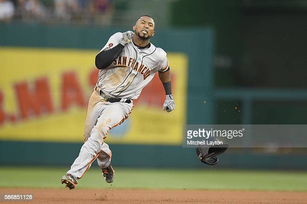 Eduardo Nunez of the San Francisco Giants runs to third for a triple in the forth inning during a baseball game against the Washington Nationals at...