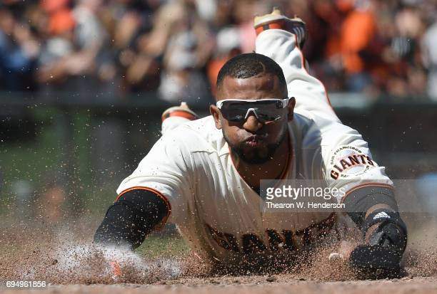 Eduardo Nunez of the San Francisco Giants scores against the Minnesota Twins in the bottom of the seventh inning at ATT Park on June 11 2017 in San...