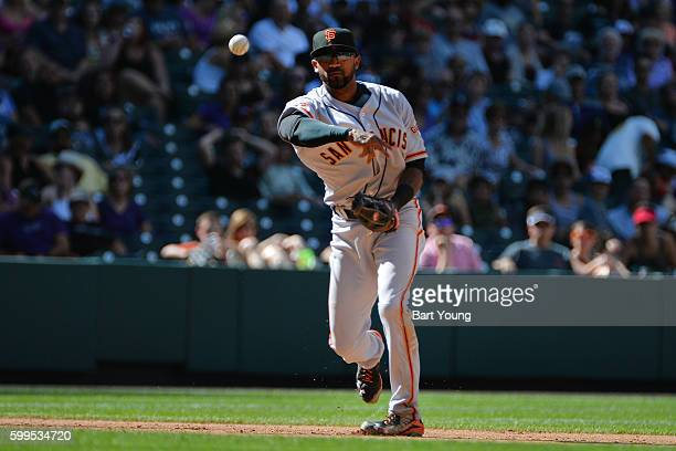 Eduardo Nunez of the San Francisco Giants throws to first base in the fourth inning against the Colorado Rockies at Coors Field on September 5 2016...