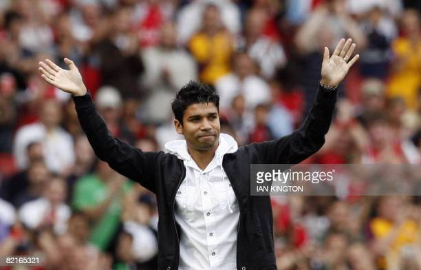 Eduardo of Arsenal acknowledges the crowd after a long period out due to an injury during the Emirates Cup competition match against Real Madrid at...
