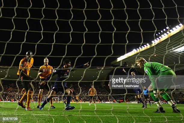Eduardo of Arsenal celebrates after Ronald Zubar of Wolverhampton Wanderers scored an own goal during the Barclays Premier League match between...