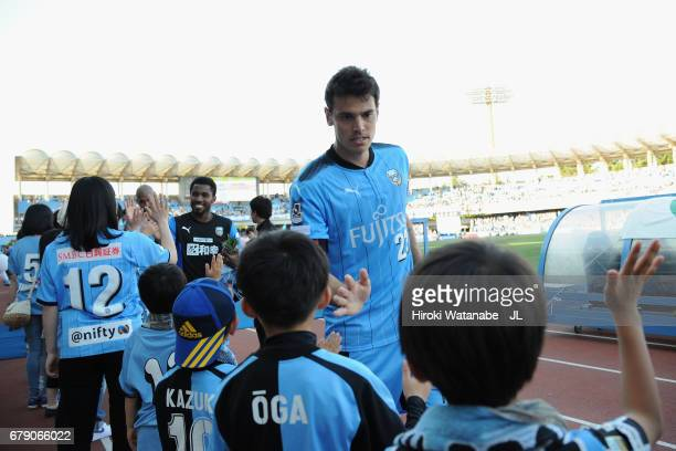 Eduardo of Kawasaki Frontale high fives with young supporters after his side's 30 victory in the JLeague J1 match between Kawasaki Frontale and...