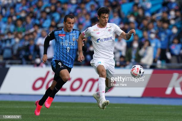 Eduardo of Sagan Tosu and Leandro Damiao of Kawasaki Frontale compete for the ball during the JLeague MEIJI YASUDA J1 match between Kawasaki Frontale...
