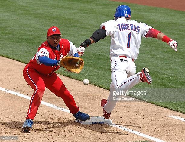 Eduardo Paret of Cuba awaits the relay as Willy Taveras of the Dominican Republic is safe on a bunt single in the Semi-Finals of the 2006 World...