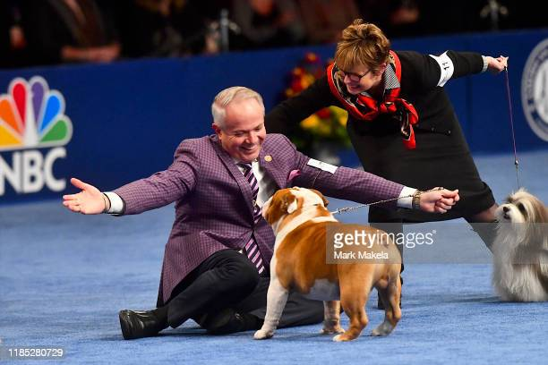 Eduardo Paris a native of Peru reacts as a bulldog named Thor wins the Best in Show at the Greater Philadelphia Expo Center on November 16 2019 in...