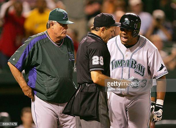 Eduardo Perez of the Tampa Bay Devil Rays argues with home plate umpire Bill Hohn as manager Lou Piniella looks on during the 9th inning of the game...