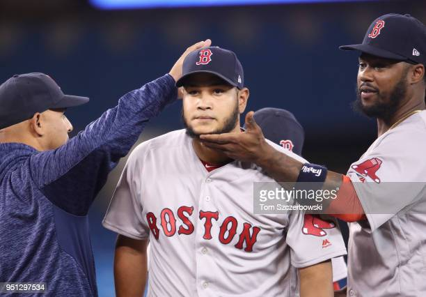 Eduardo Rodriguez of the Boston Red Sox exits as he is relieved by manager Alex Cora as Hanley Ramirez lifts his chin up in the seventh inning during...