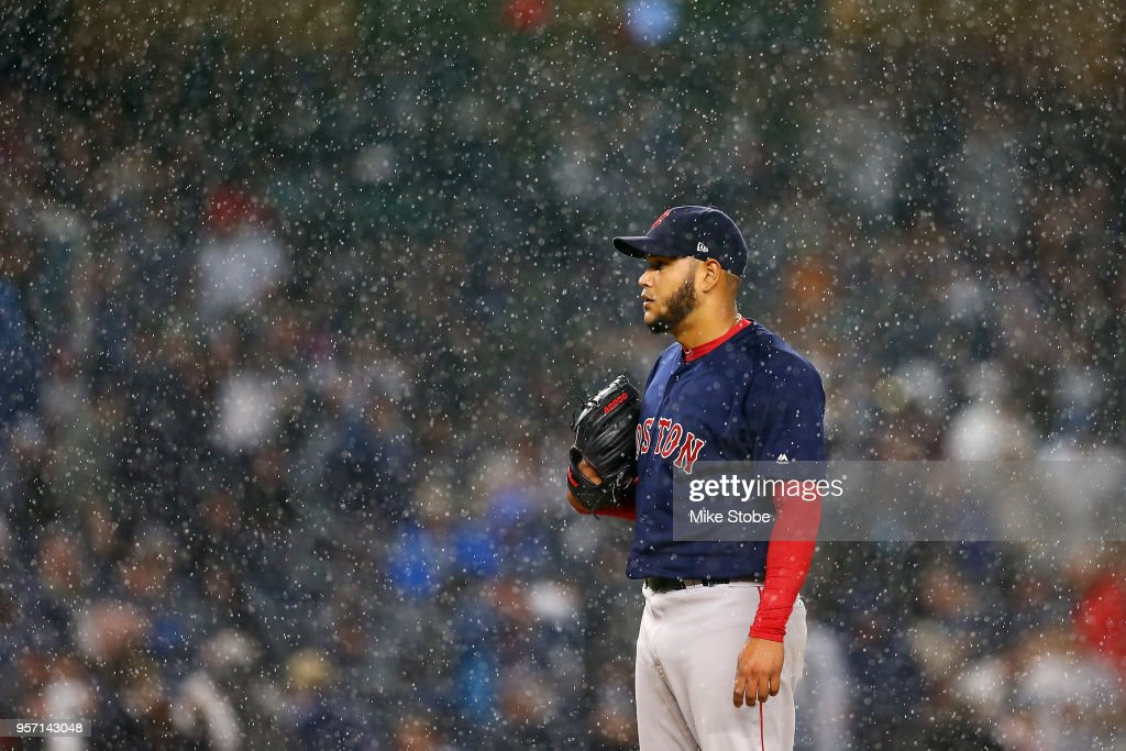 Eduardo Rodriguez #57 of the Boston Red Sox gets set to pitch as the rain falls in the fourth inning against the New York Yankees at Yankee Stadium on May 10, 2018 in the Bronx borough of New York City.