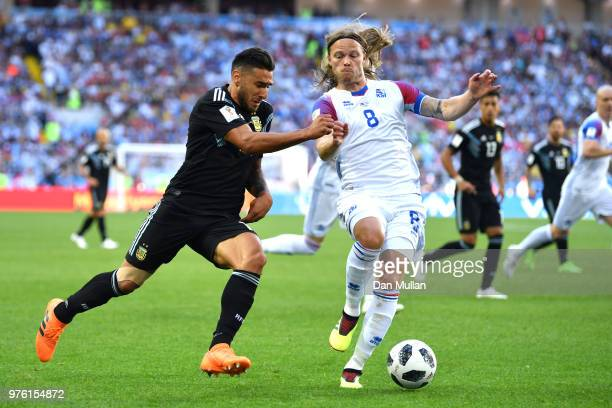 Eduardo Salvio of Argentina battles for possession with Birkir Bjarnason of Iceland during the 2018 FIFA World Cup Russia group D match between...