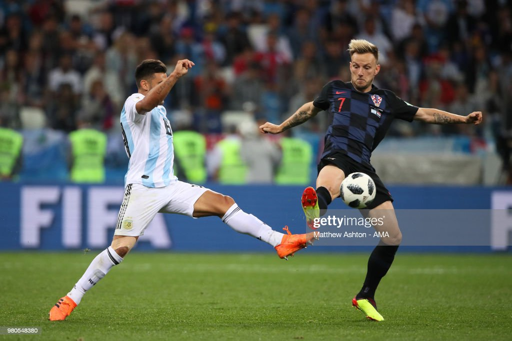 Eduardo Salvio of Argentina competes with Ivan Rakitic of Croatia during the 2018 FIFA World Cup Russia group D match between Argentina and Croatia at Nizhny Novgorod Stadium on June 21, 2018 in Nizhny Novgorod, Russia.