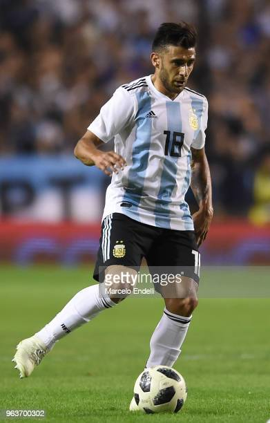 Eduardo Salvio of Argentina drives the ball during an international friendly match between Argentina and Haiti at Alberto J Armando Stadium on May 29...