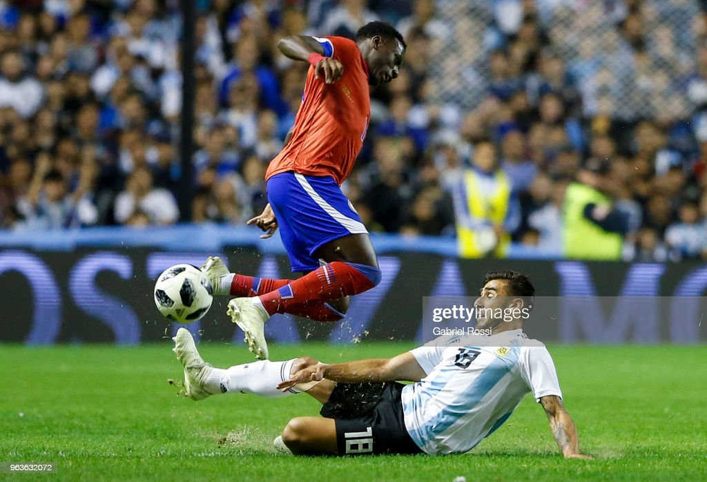 Eduardo Salvio of Argentina fights for the ball with Derrick Etienne of Haiti during an international friendly match between Argentina and Haiti at Alberto J. Armando Stadium on May 29, 2018 in Buenos Aires, Argentina.
