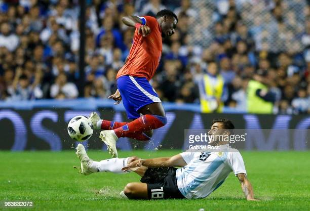 Eduardo Salvio of Argentina fights for the ball with Derrick Etienne of Haiti during an international friendly match between Argentina and Haiti at...