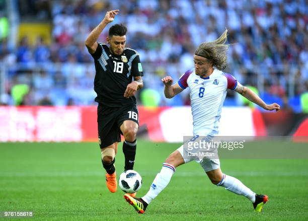 Eduardo Salvio of Argentina is challenged by Birkir Bjarnason of Iceland during the 2018 FIFA World Cup Russia group D match between Argentina and...