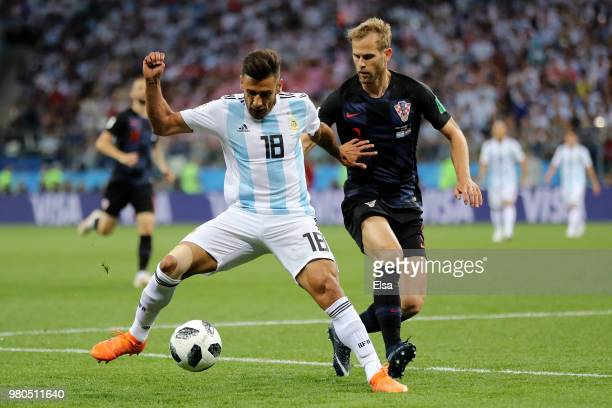 Eduardo Salvio of Argentina is challenged by Ivan Strinic of Croatia during the 2018 FIFA World Cup Russia group D match between Argentina and...