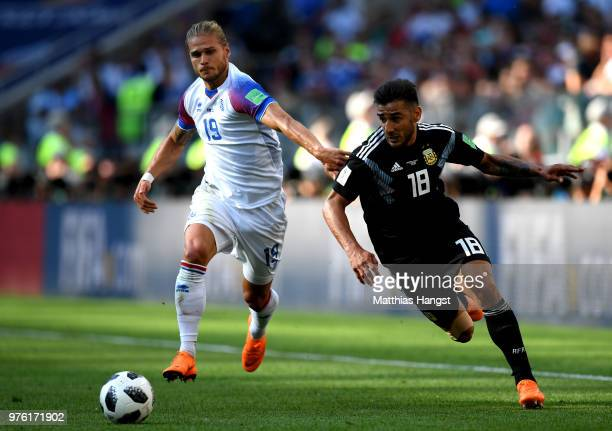 Eduardo Salvio of Argentina is challenged by Rurik Gislason of Iceland during the 2018 FIFA World Cup Russia group D match between Argentina and...
