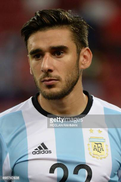 Eduardo Salvio of Argentina poses before the start of their international friendly football match against Singapore at the National Stadium in...