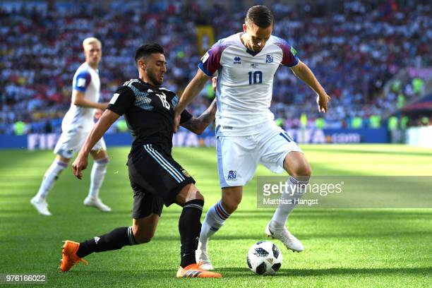 Eduardo Salvio of Argentina tackles Gylfi Sigurdsson of Iceland during the 2018 FIFA World Cup Russia group D match between Argentina and Iceland at...