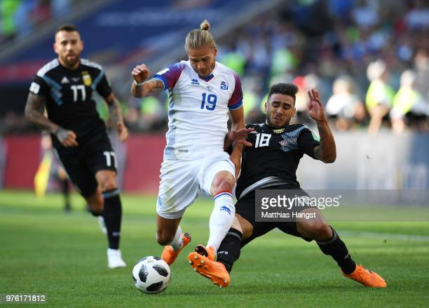 Eduardo Salvio of Argentina tackles Rurik Gislason of Iceland during the 2018 FIFA World Cup Russia group D match between Argentina and Iceland at...