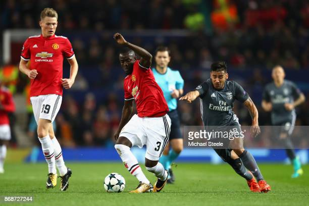 Eduardo Salvio of Benfica chases down Eric Bailly of Manchester United during the UEFA Champions League group A match between Manchester United and...