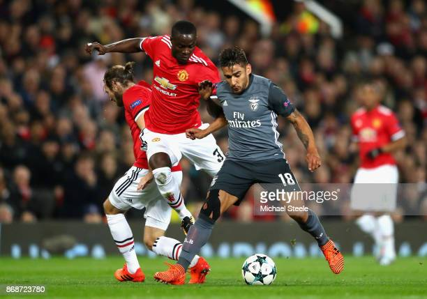 Eduardo Salvio of Benfica is tackled by Eric Bailly of Manchester United during the UEFA Champions League group A match between Manchester United and...