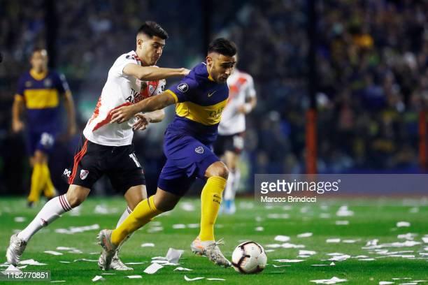 Eduardo Salvio of Boca Juniors and Exequiel Palacios of River Plate fight for the ball during the Semifinal second leg match between Boca Juniors and...