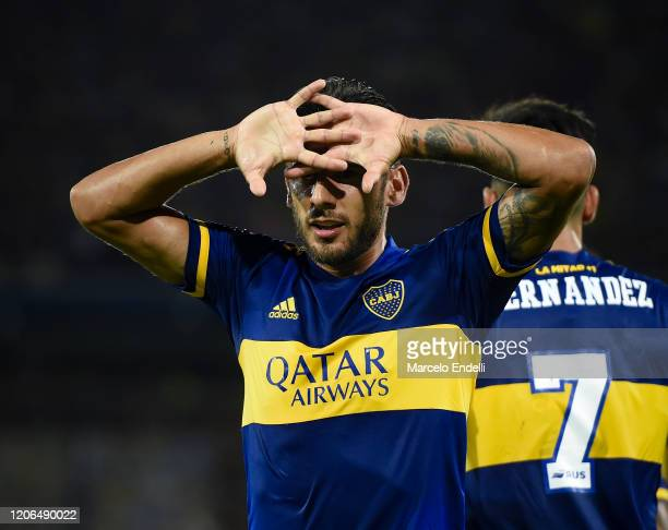 Eduardo Salvio of Boca Juniors celebrates after scoring the first goal of his team during a Group H match between Boca Juniors and Deportivo...