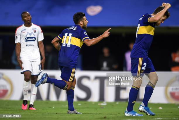Eduardo Salvio of Boca Juniors celebrates after scoring the second goal of his team during a Group H match between Boca Juniors and Deportivo...
