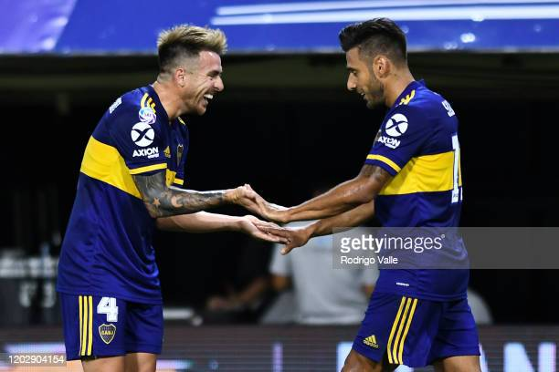 Eduardo Salvio of Boca Juniors celebrates with teammate Julio Buffarini after scoring the second goal of his team during a match between Boca Juniors...
