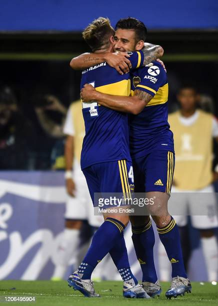 Eduardo Salvio of Boca Juniors celebrates with teammate Julio Buffarini after scoring the second goal of his team during a Group H match between Boca...