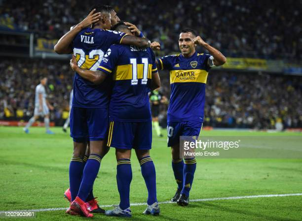 Eduardo Salvio of Boca Juniors celebrates with teammates after scoring the second goal of his team during a match between Boca Juniors and Godoy Cruz...