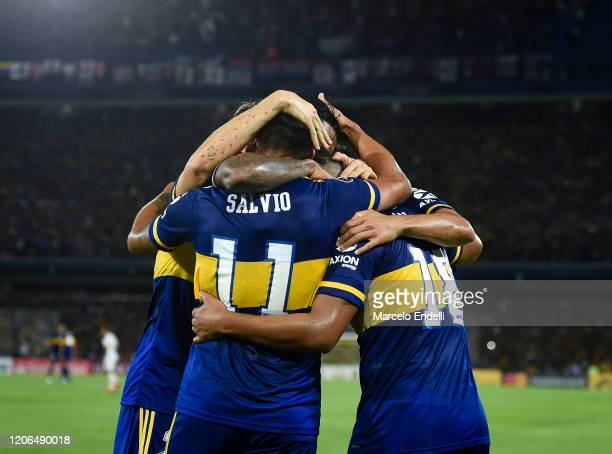 Eduardo Salvio of Boca Juniors celebrates with teammates after scoring the first goal of his team during a Group H match between Boca Juniors and...