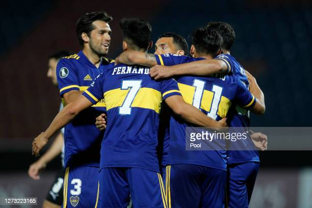Eduardo Salvio of Boca Juniors celebrates with teammates after scoring the opening goal during a group H match of Copa CONMEBOL Libertadores 2020...