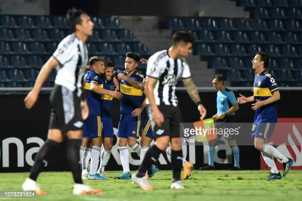 Eduardo Salvio of Boca Juniors celebrates with teammates after scoring the second goal of his team during a group H match of Copa CONMEBOL...