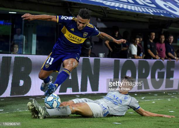Eduardo Salvio of Boca Juniors fights for the ball with Gianluca Ferrari of Godoy Cruz during a match between Boca Juniors and Godoy Cruz as part of...