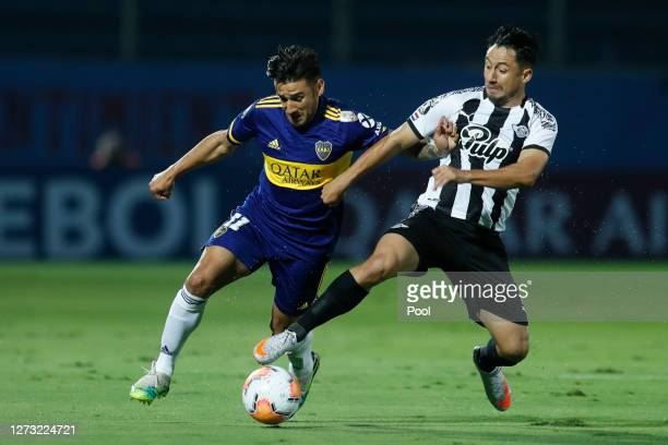 Eduardo Salvio of Boca Juniors fights for the ball with Ivan Piris of Libertad during a group H match of Copa CONMEBOL Libertadores 2020 between...