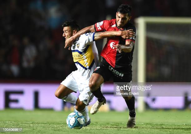 Eduardo Salvio of Boca Juniors fights for the ball with Rafael Delgado of Colon during a match between Colon and Boca Juniors as part of Superliga...