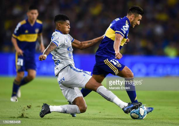Eduardo Salvio of Boca Juniors fights for the ball with Wilder Cartagena of Godoy Cruz during a match between Boca Juniors and Godoy Cruz as part of...