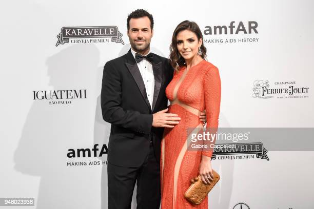 Eduardo Scarpa and Caroline Celico attends the 2018 amfAR gala Sao Paulo at the home of Dinho Diniz on April 13 2018 in Sao Paulo Brazil