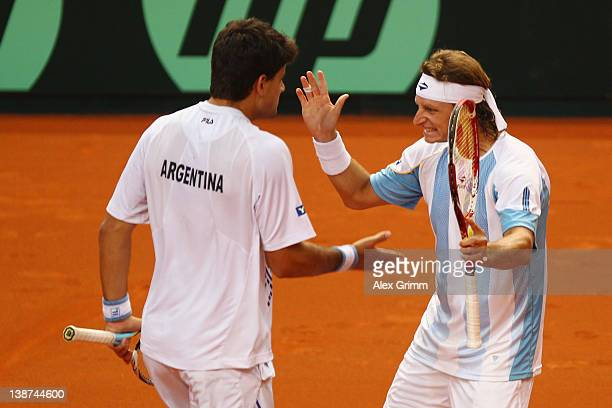 Eduardo Schwank and David Nalbandian of Argentina celebrate during their doubles match against Tommy Haas and Philipp Petzschner of Germany during...