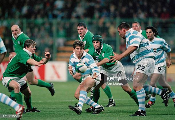 Eduardo Simone of Argentina passes to teammate Martin Scelzo during a Rugby World Cup quarter-final play-off match against Ireland at Twickenham,...