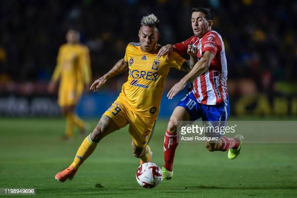 Eduardo Vargas, #9 of Tigres, fights for the ball with Camilo Mayada, #18 of San Luis, during the 1st round match between Tigres UANL and Atletico...