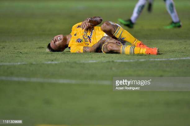 Eduardo Vargas, #9 of Tigres, lies on the field after being injured during the Final first leg match between Tigres UANL and Leon as part of the...