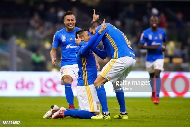 Eduardo Vargas Anselmo Vendrechovski Juninho and AndrePierre Gignac of Tigres celebrate their team's first goal during the semifinal first leg match...