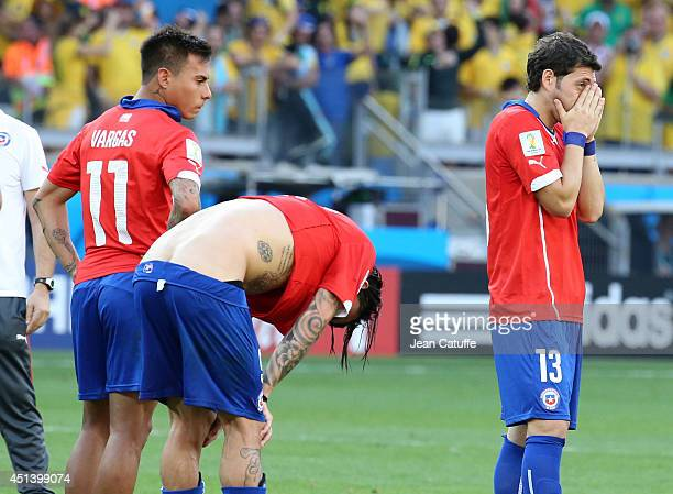 Eduardo Vargas Mauricio Pinilla and Jose Rojas of Chile react after losing the 2014 FIFA World Cup Brazil round of 16 match between Brazil and Chile...
